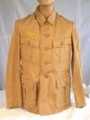 Un-issued, mint Kriegsmarine tropical tunic with original Amsterdam maker's paper tag